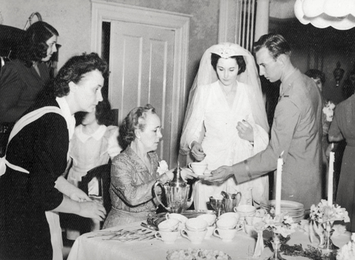 Ethel Maude Miller Boyd pouring tea at the wedding reception of her sister Lucy Healy's daughter, Hope Healy, to Cletus Joseph Gombold, 16 May 1944.